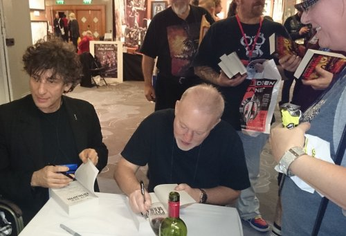 Neil Giaman and Stephen Jones sign Psycho-Mania! at the Mammoth book signing at World Fantasy Convention 2013, November 2