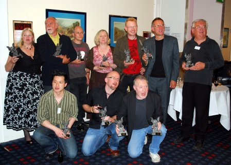 2009 British Fantasy Awards. Left to right (back row): Jo Fletcher, Peter Crowther, Andrew Hook, Alyson Bird, Joseph D'Lacey, Graham Joyce and Ramsey Campbell; (front row) Vincent Chong, Tim Lebbon and a shouty Stephen Jones.