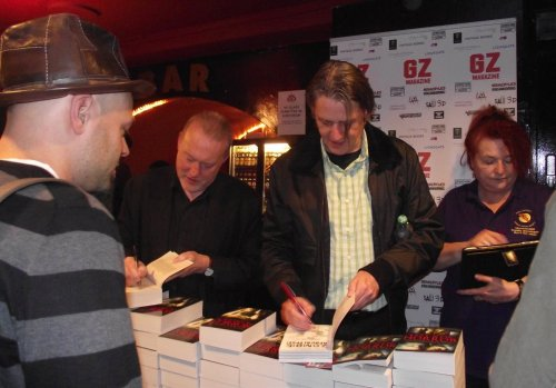 Stephen Jones signing books with Paul McAuley and Pat Cadigan