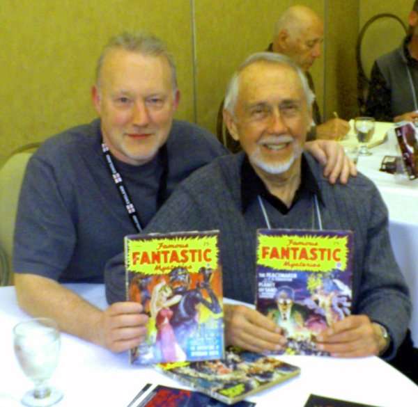 Stephen Jones gets Don Hutchison to sign his copies of FAMOUS FANTASTIC MYSTERIES.